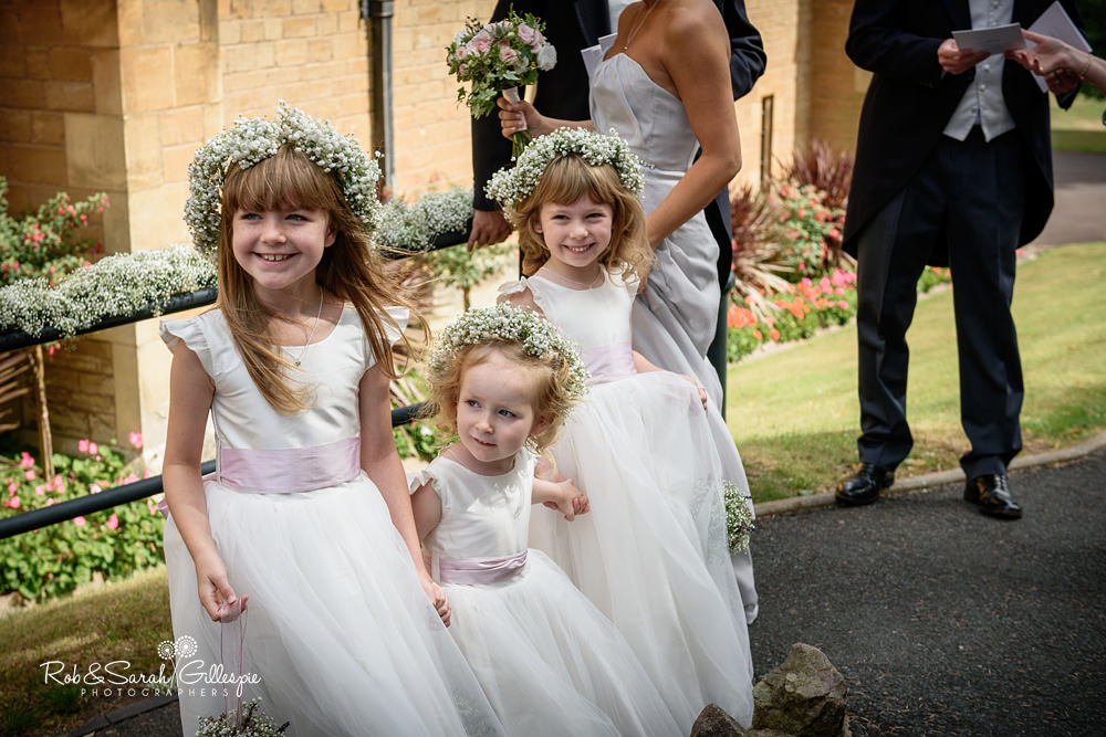 Flowergirls and pageboy wait for bride at Malvern College chapel