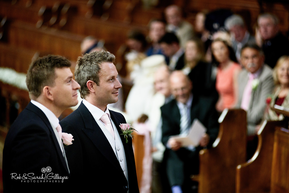 Groom and best man inside Malvern College chapel before wedding service