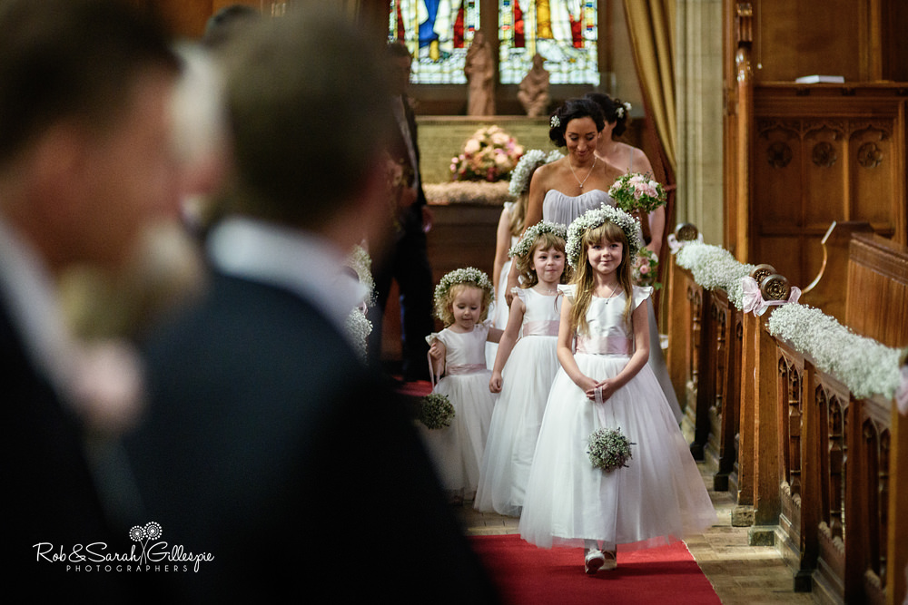 Bride and bridesmaids enter Malvern College chapel for wedding service
