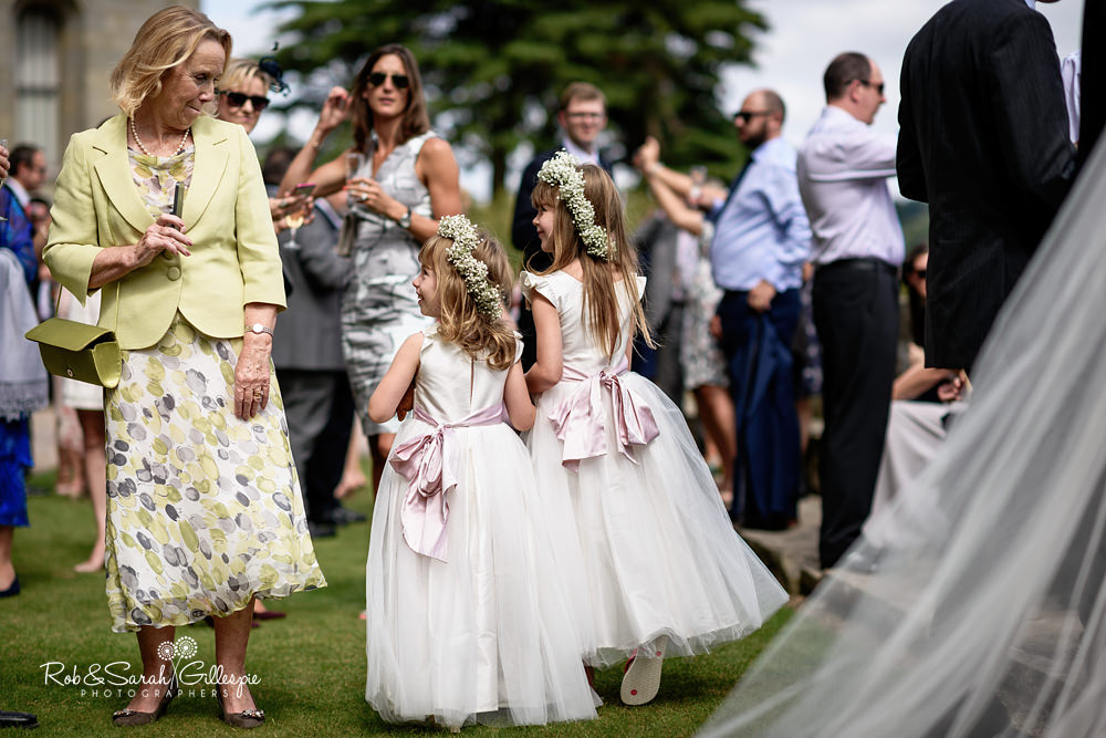 Wedding guests enjoy drinks reception at Eastnor Castle