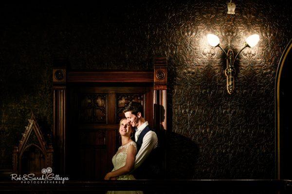 Bride and groom on balcony at Highbury Hall