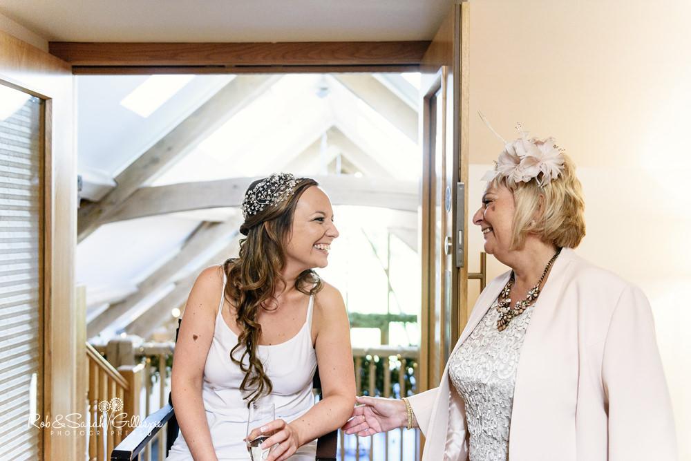 Bride and mum share a laugh at Mythe Barn