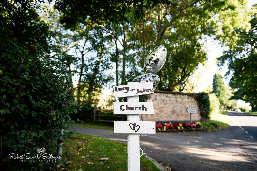 Sign showing way to wedding at All Saints church Grendon, Warwickshire