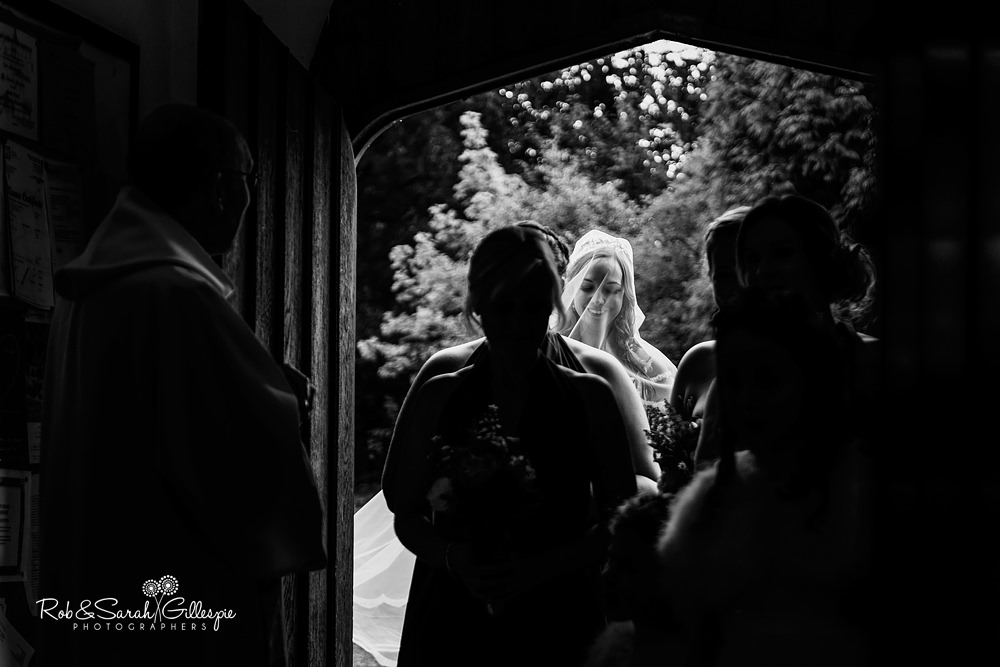 Bride enters All Saints church Grendon for wedding