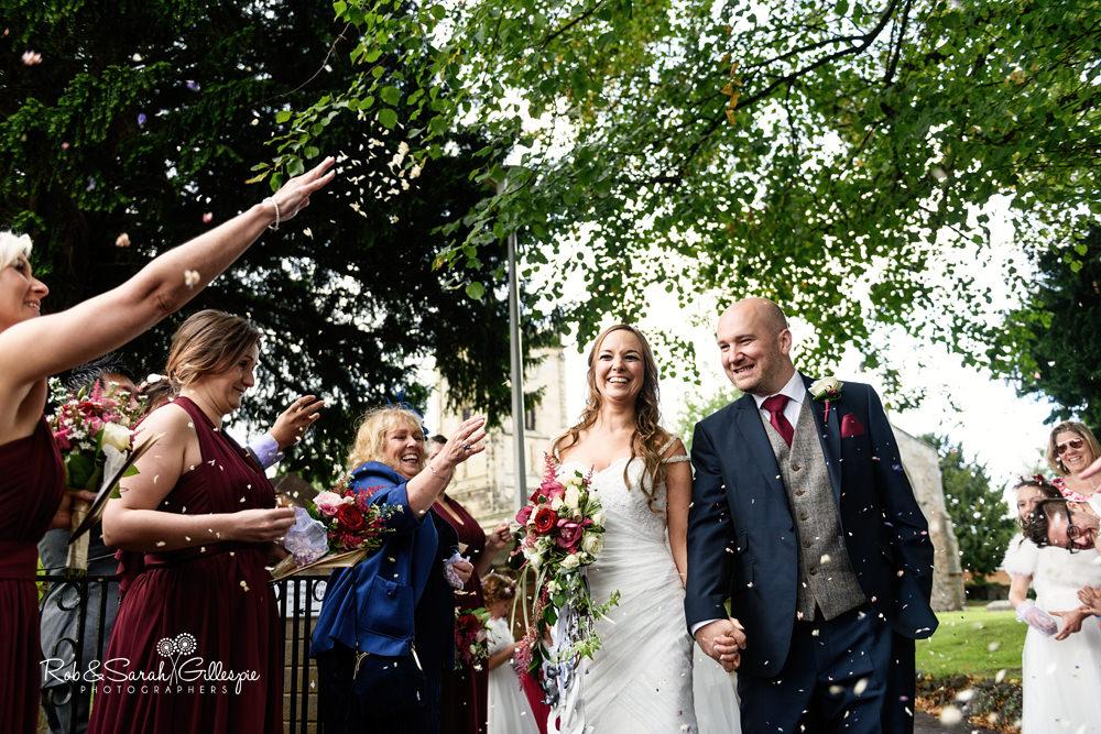 Confetti thrown at wedding at All Saints church Grendon