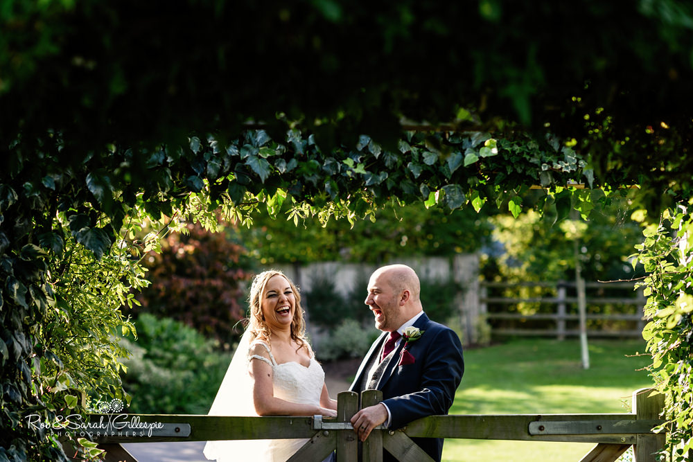 Bride and groom together in grounds at Mythe Barn