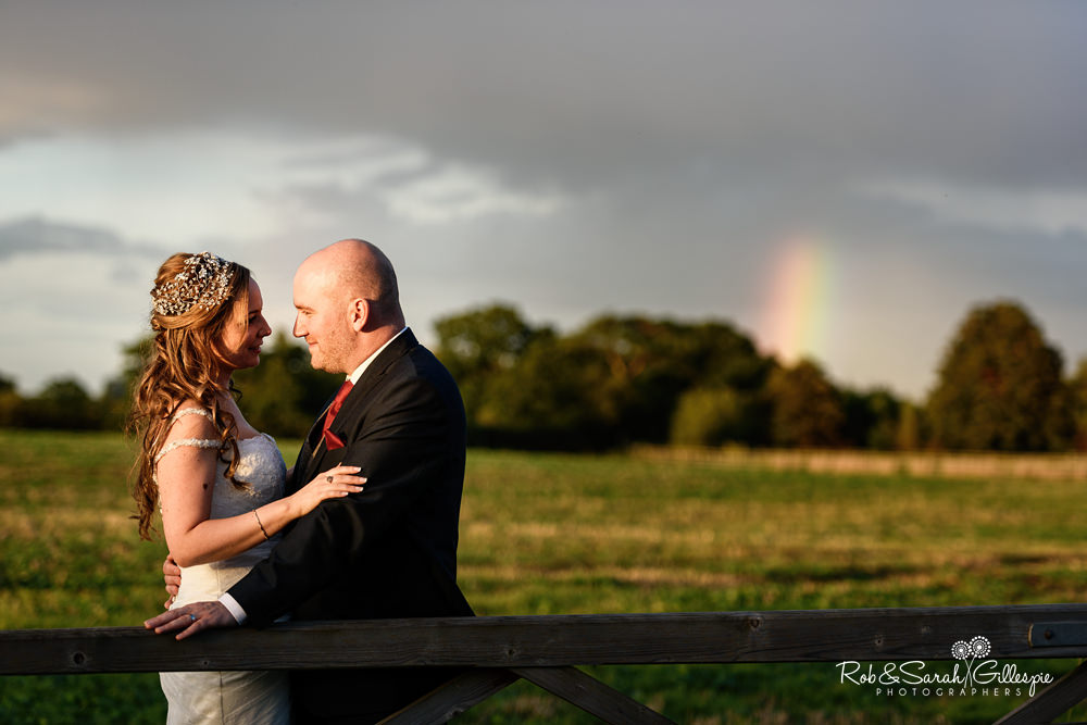 Bride and groom together at Mythe Barn in beautiful evening light