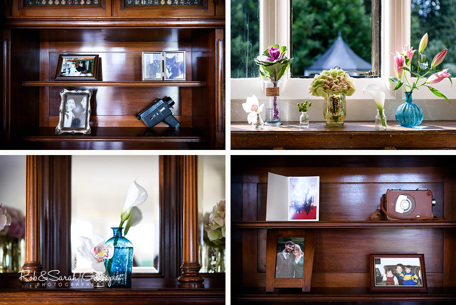 Flowers and family photos on display ready for wedding at Pendrell Hall