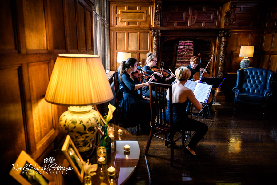 String quartet play in Pendrell Hall pannelled room