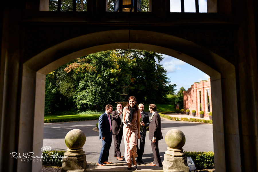 View through archway at Pendrell Hall as guests arrive for wedding