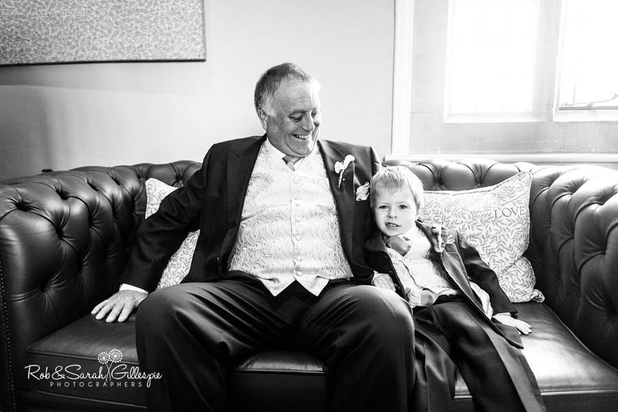 Bride's father and pagebooy on sofa at Pendrell Hall