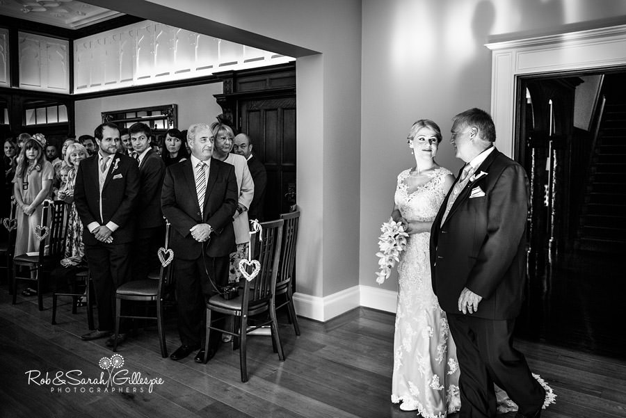 Bride and father make their entrance into wedding service at Pendrell Hall