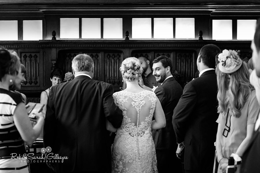 Groom turns around to see his bride
