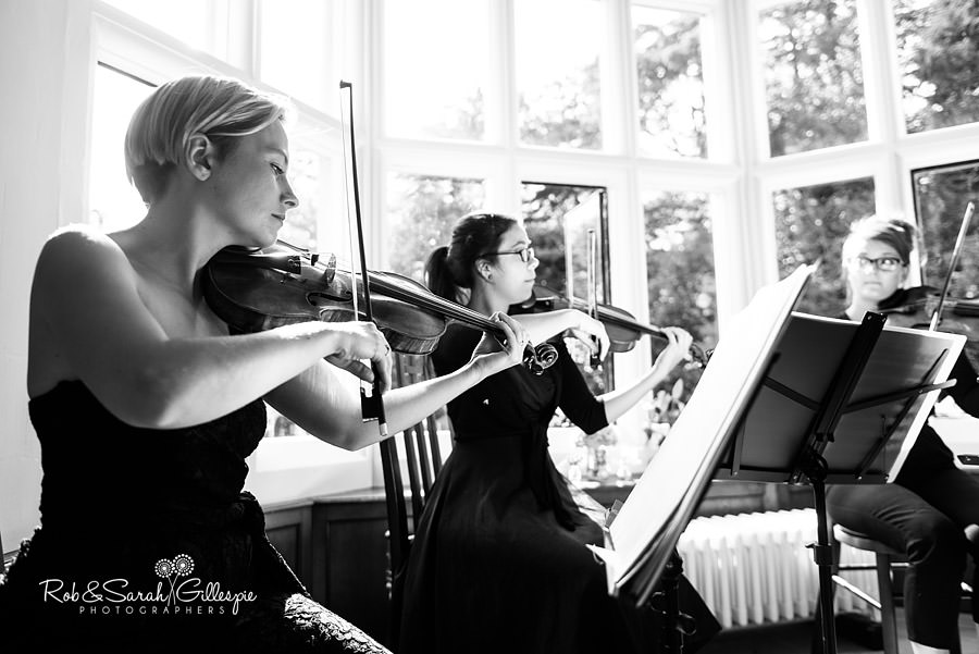 String quartet play during wedding service in Pendrell Hall Morning Room