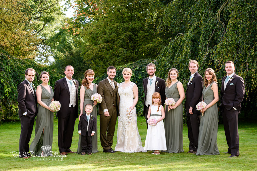 Group photo in Pendrell Hall gardens bride, groom, bridesmaids and ushers