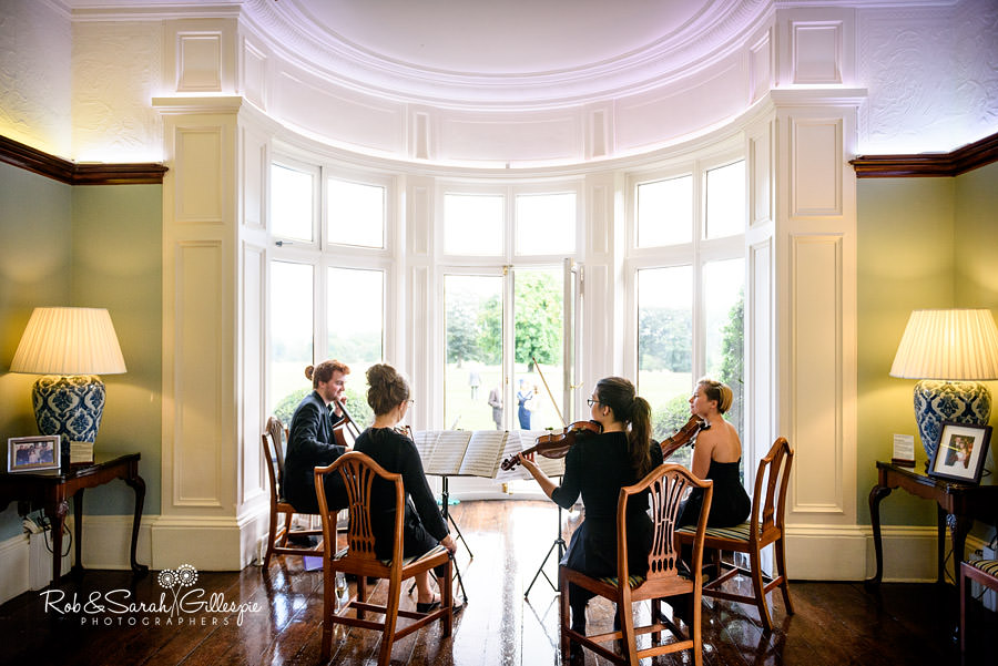 String quartet play during drinks reception
