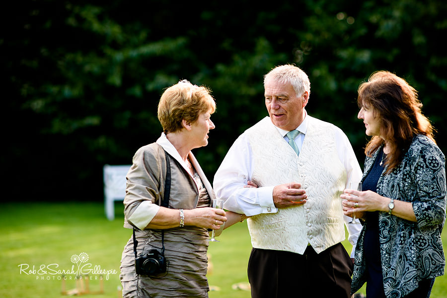 Wedding guests chat during drinks reception