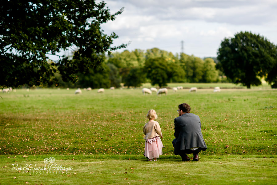 Young girl and father enjoy the view from Pendrell Hall gardens across the Staffordshire countryside
