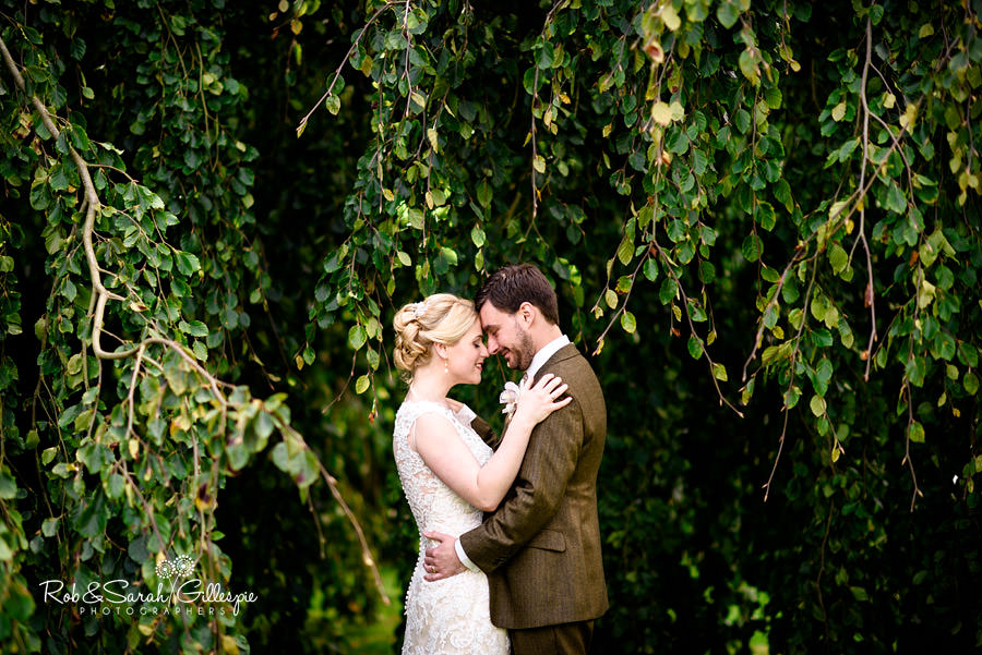 Bride and groom together in trees at Pendrell Hall