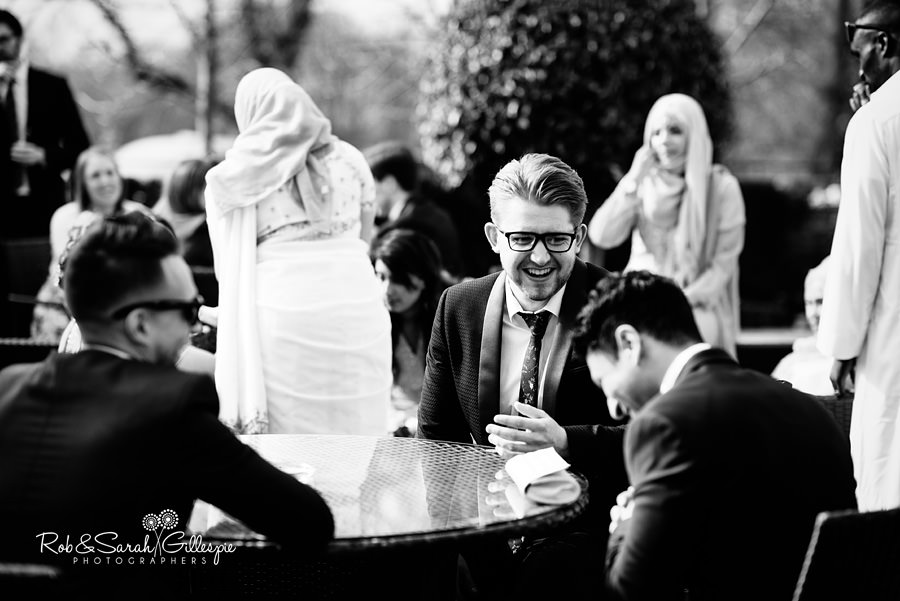 Wedding guests relax in sunshine at Warwick House