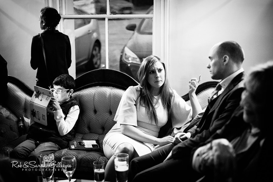 Wedding guests relax during reception at Warwick House