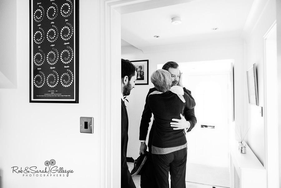 Groom's mum hugs best man