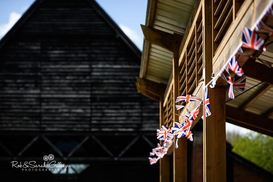 Union Flags flutter in breeze outside Avoncroft Guesten Hall
