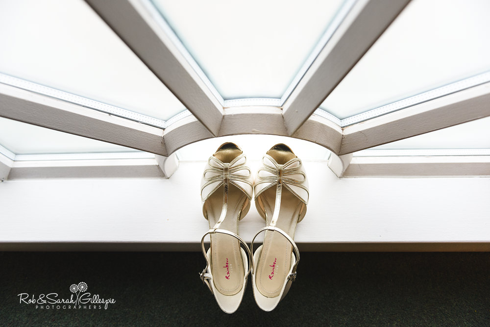 Wedding shoes in decorative window