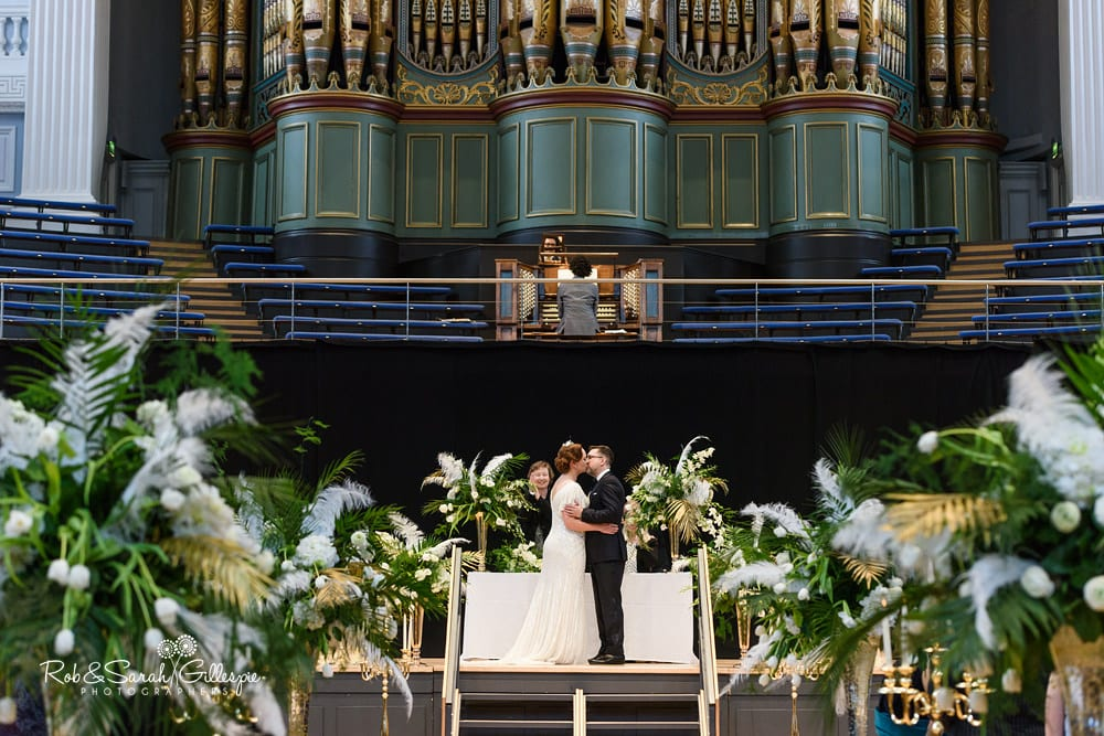 Bride and groom first kiss as husband and wife at Birmingham Town Hall wedding