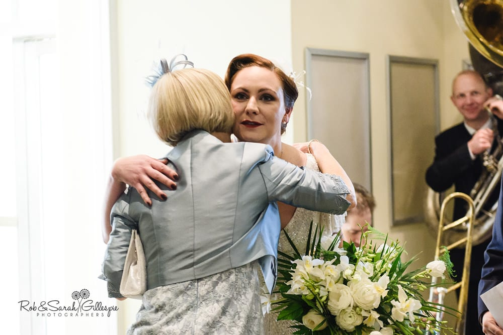 Bride hugs wedding guest in Birmingham Town Hall