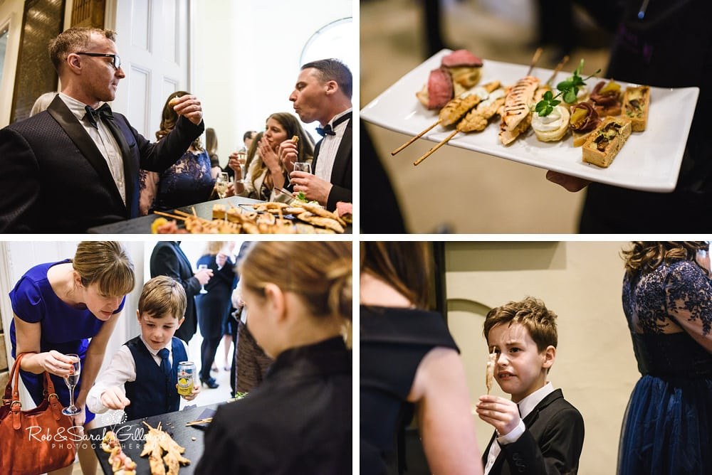 Wedding guests enjoy canapés during Birmingham Town Hall wedding reception