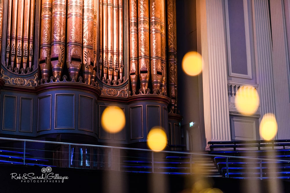 Candelabra in front of pipe organ inside Birmingham Town Hall