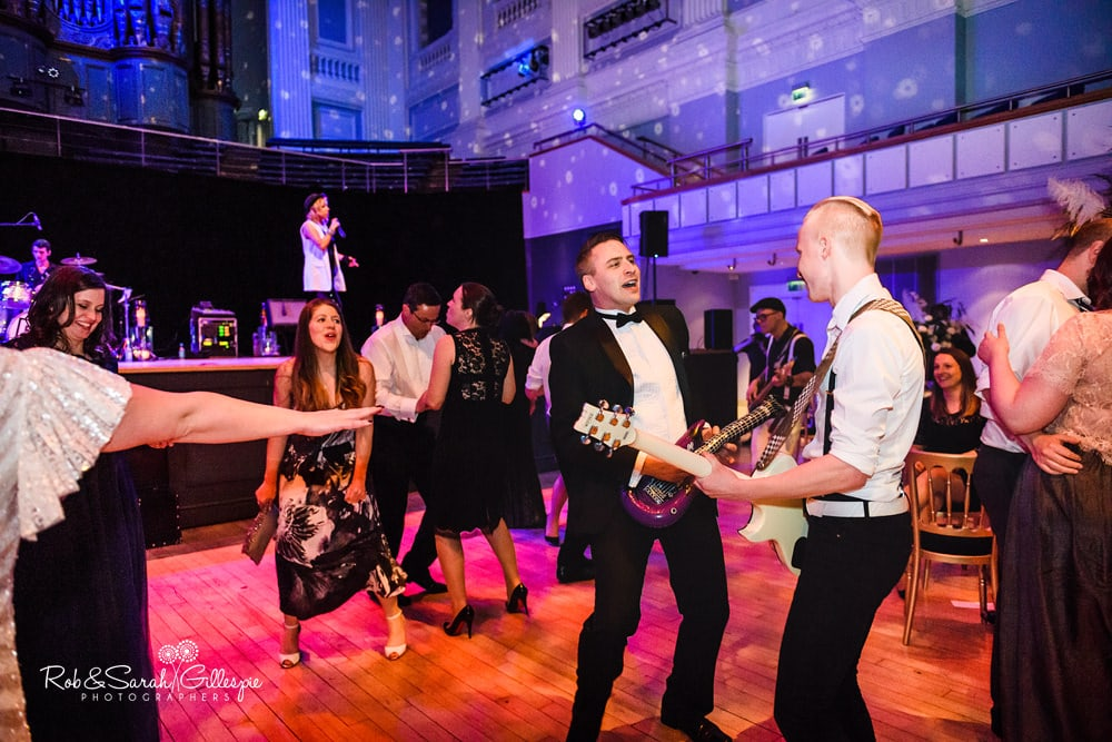 Live band play at Birmingham Town Hall wedding as guests dance and enjoy reception party