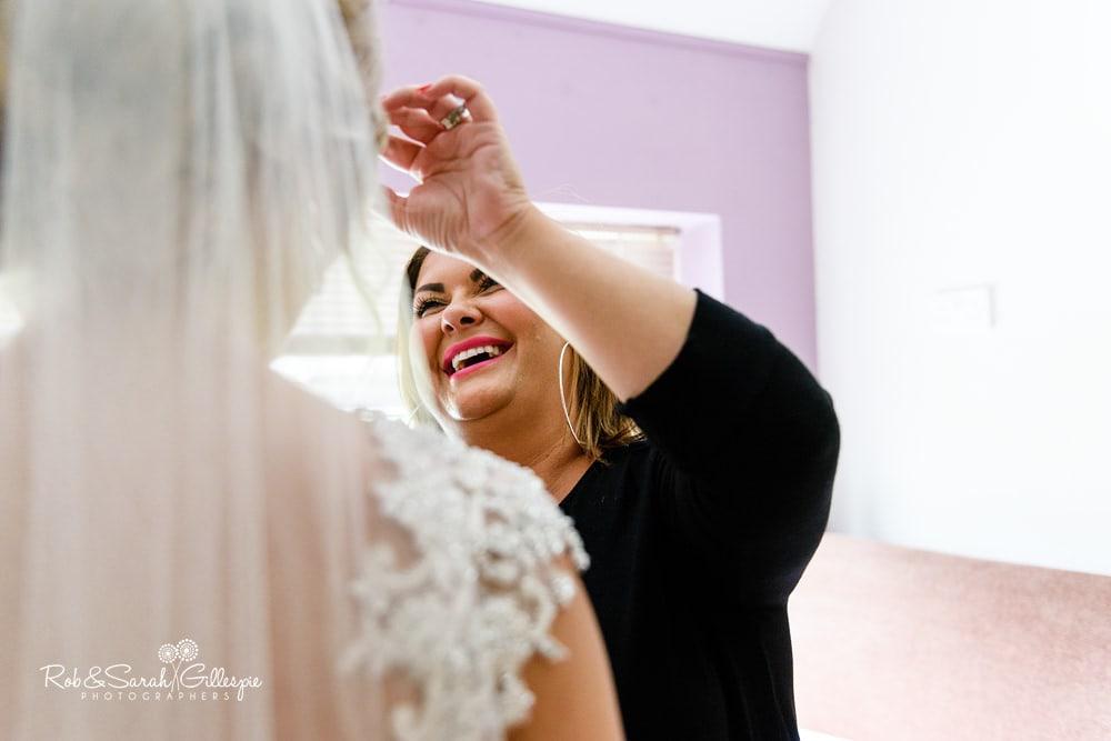 Bride has veil adjusted