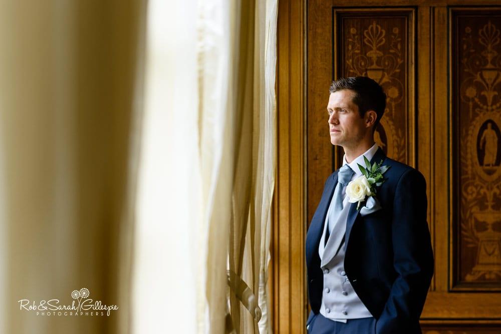 Groom greets wedding guests at Alrewas Hayes