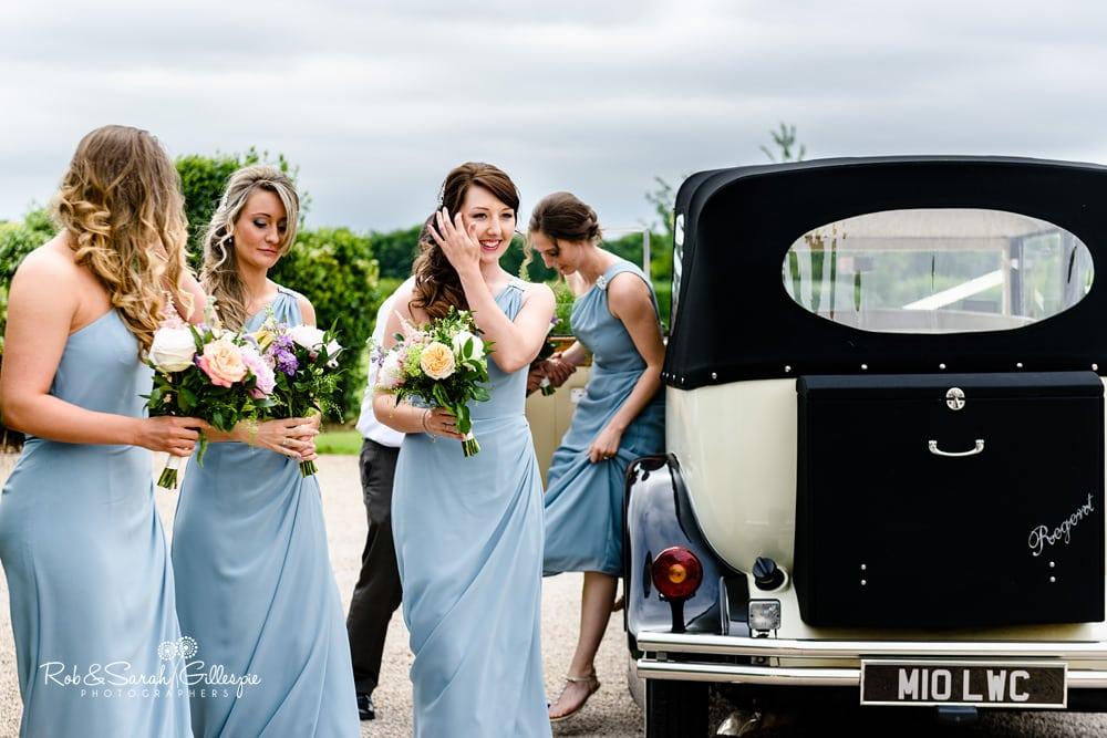 Bride gets out of wedding car at Alrewas Hayes