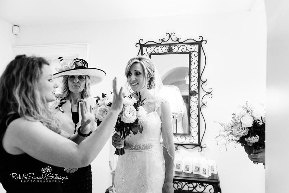 Groom waits for bride at Alrewas Hayes wedding