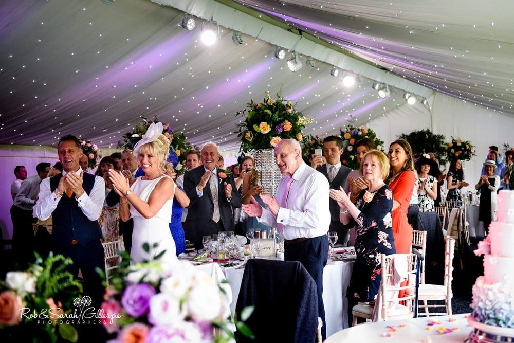 Bride and groom drink shots before entering wedding meal at Alrewas Hayes