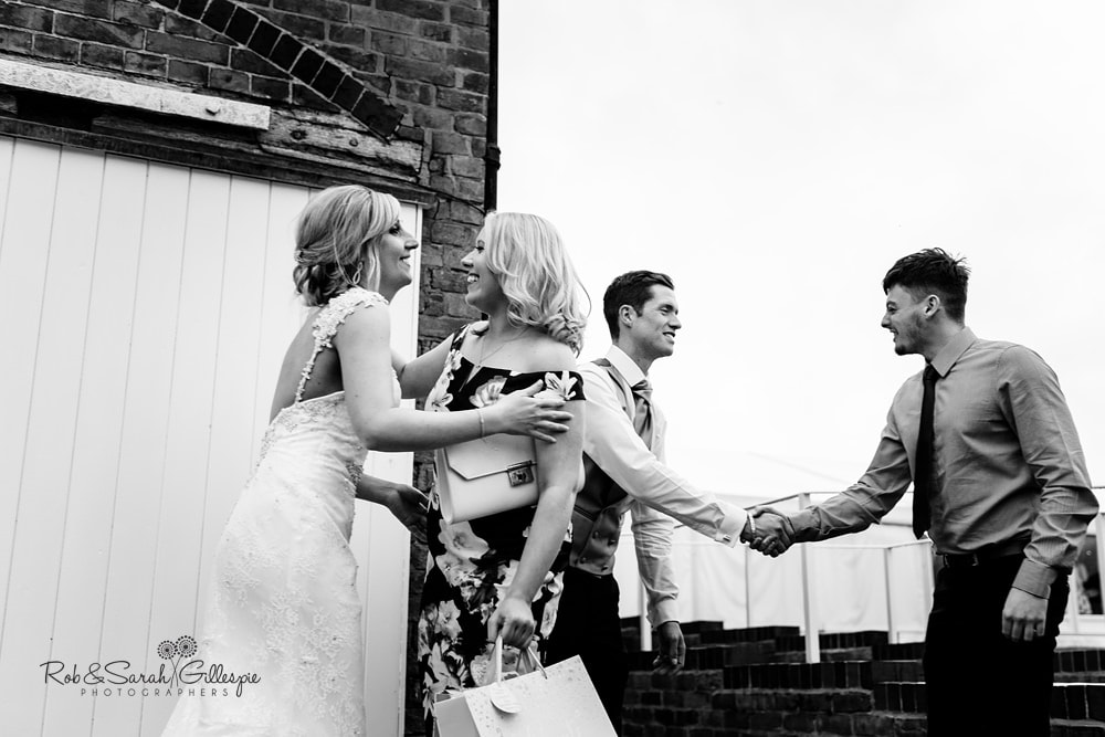 Bride and groom greet evening guests at Alrewas Hayes wedding