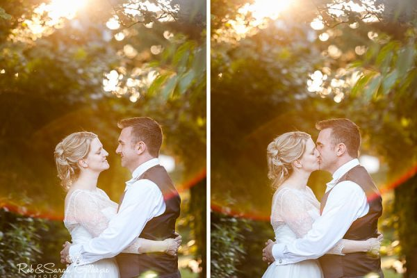Bride and groom kiss in grounds at Nuthurst Grange