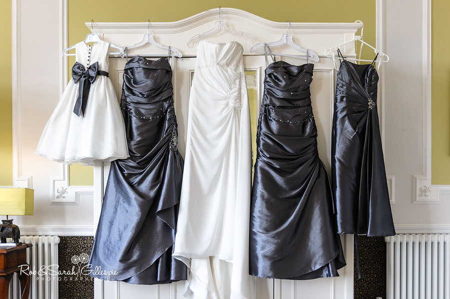 wedding and bridesmaid dresses hanging up at chateau impney