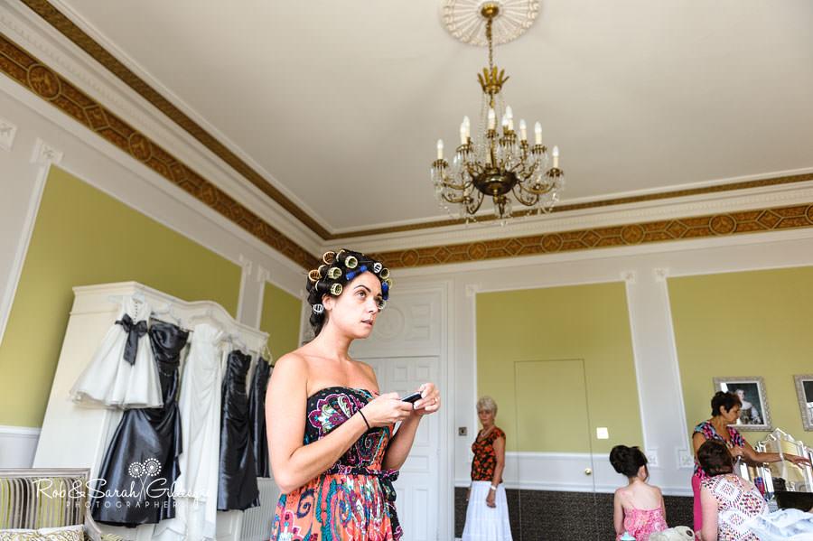 bride in rollers before wedding
