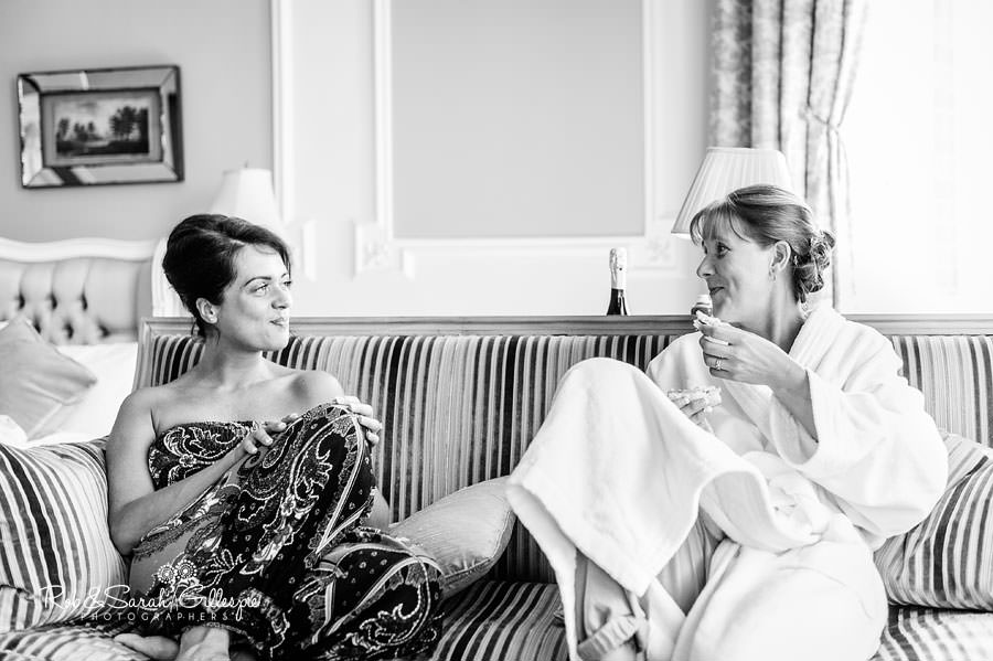 bride and bridesmaid relaxing at chateau impney hotel