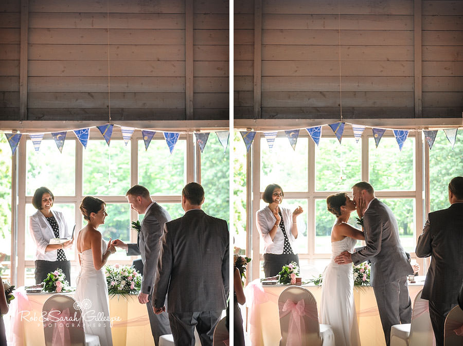 bride and groom kiss during wedding service