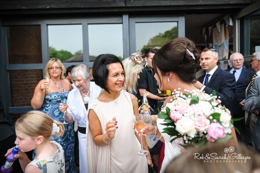 guest congratulates bride after wedding