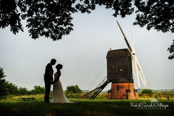 Avoncroft Museum windmill with bride and groom silhouetted