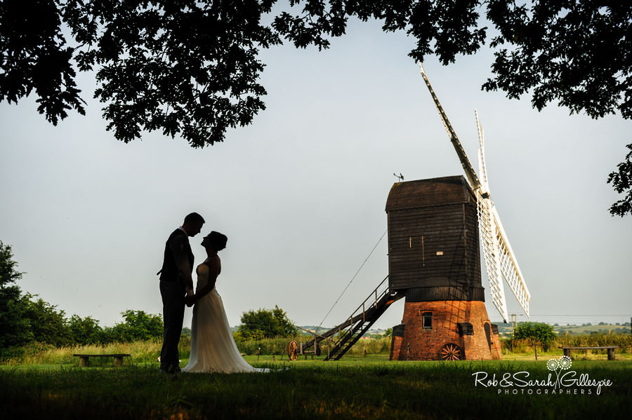 bride and groom in silhouette with avoncroft museum windmill