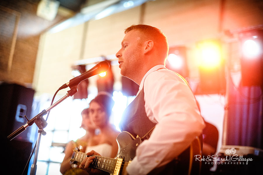 groom sings for bride at wedding reception