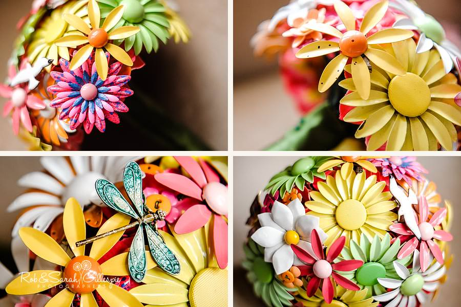 details of colourful wedding bouquet made from metal brooches