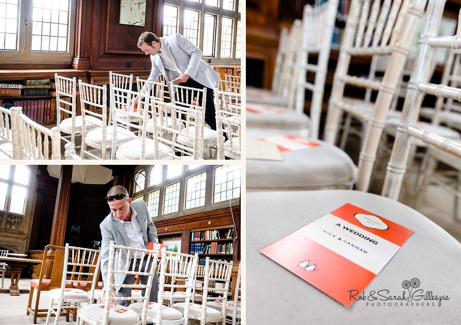 groomsmen placing order of service on chairs